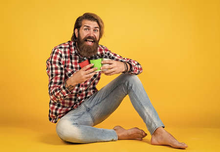 he likes all. man drink hot tea from paper cup. good morning. energetic warm take away beverage. need some coffee to go for inspiration. happy bearded man drinking morning coffee