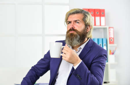 management consultant or analysts drink morning coffee. charismatic financial analysts. working as actuary. skills business majors have. skilled accountant wear office jacket Zdjęcie Seryjne