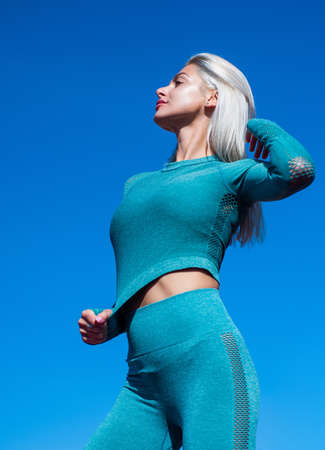 woman fitness trainer with sexy tight buttocks in stylish sportswear, fitness Reklamní fotografie