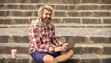 bearded man sit on stairs with laptop. online distant education. inspired to work with coffee. agile business. mature student working on computer. go shopping on cyber monday. Confident graduate