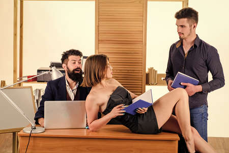 Stimulate sexual desire. Woman working in mostly male collective. Intentional sexual provocation. Woman attractive lady working with men colleagues. Office atmosphere concept. Sexual attraction