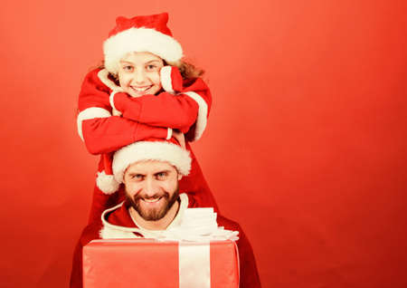 Girl little cute child and bearded father wear santa costume. Christmas party. How to be santa claus parents guide. Belief in santa constitutes most magical part of childhood. My dad is santa claus