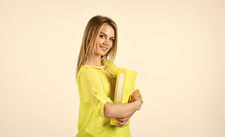 casual fashion style. beautiful woman has stylish hair. girl work with documents. lady with folder in hands. natural beauty concept. elegant smiling woman. trendy office worker. Always available