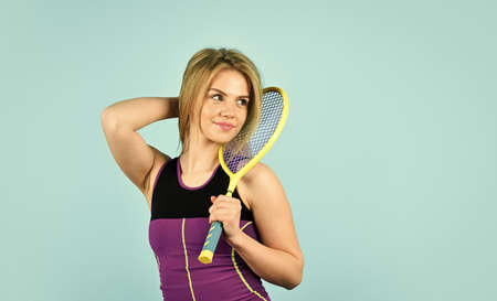 Smiling athletic girl hold tennis racket. In Pursuit of Good Health. Girl tennis player. Sport competition. Squash game. Woman athlete play tennis court. Scoring system. Racquet sports. Tennis club Banque d'images