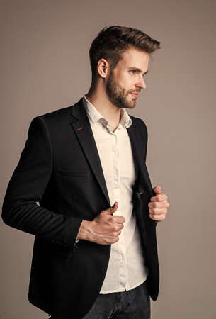 Young and free. confident businessman in shirt and jacket. boss male. sexy ceo on gray background. modern office life. charismatic business owner. stylish realtor. handsome man wear formal suit 免版税图像