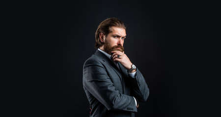 official office lifestyle. serious bearded man. handsome and successful man in expensive suit. He is in shirt. stylish successful man in suit posing. business man wear suit. illusionist