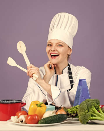 restaurant kitchen lifestyle. happy chef cooking vegetables. healthy food and diet. woman housewife in cook hat and apron. fresh and raw preparing. full of vitamin. natural and organic Banque d'images