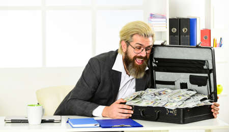 Businessman with cash. Bank account. Credit and cash concept. Corporate finance. Economics concept. He loves money. More Sales Without Extensive Spending. Cash turnover. Company income fraud 免版税图像