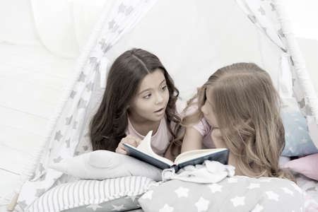 Imagination ran away with them. Little girls read and imagine during bedtime. Cute dreamers with book. Kids imagination and fantasy. Creative imagination. Reading feeds imagination
