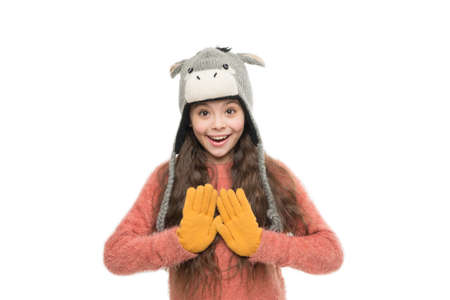 cute beauty isolated on white. warm in any weather. let it snow. ski resort. get ready for winter holiday. homemade knit. little playful girl in winter look smiling. Fashion concept. wash it by hand.