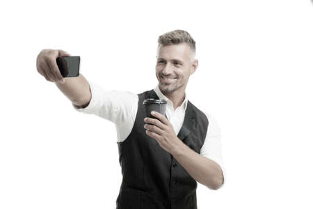 Lifestyle blogger on coffee break. Handsome well groomed man taking selfie photo for personal blog. Online blog. Digital influencer concept. Video call communication. Personal blog social networks Stockfoto