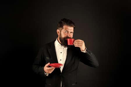 Man bearded hipster drinking coffee. Drinking coffee. Businessman enjoy coffee break. Relax concept. Preparing caffeine beverage using coffee machine. Cafe equipment shop. Serving perfect espresso 免版税图像