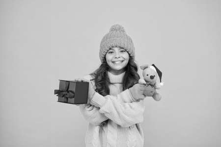 cute santa mice toy gift. small girl hold mouse toy and present box. child knitted clothes play with toy rat. toy shop for kids. christmas is here. xmas favorite winter holiday. happy new 2020 year