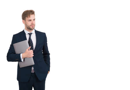 Handsome man in formal style hold computer using digital information and communication technology for work, e-business, copy space Stock Photo