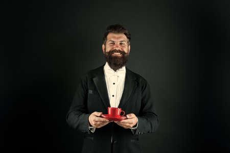 Drinking coffee. Aromatic pleasure. Man bearded hipster drinking coffee. Businessman enjoy coffee break. Relax concept. Preparing caffeine beverage using coffee machine. Cafe equipment shop 免版税图像