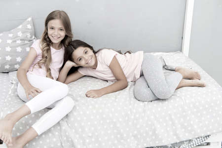 Good morning concept. Great start of day. Children cheerful play bedroom. Happy childhood moments. Joy and happiness. Happy together. Kids girls sisters best friends full of energy in cheerful mood