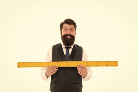 Learning metric system. School teacher. Size really matters. Man bearded hipster holding ruler. Measure length. Measure and control. Geometry theorem. Measure with centimeters. Size table concept