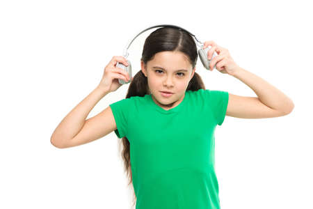 Small kid listen music headphones. No ad interruptions. Play any song. Try premium account. Enjoy nonstop music. Privilege of premium music account. Little girl listen music modern headphones