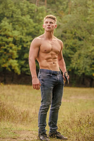 full of energy. brutal and attractive male in wood. bodybuilder show his muscles. power and strength. lumberjack carry axe. man strong body. muscular man with axe. macho torso ax