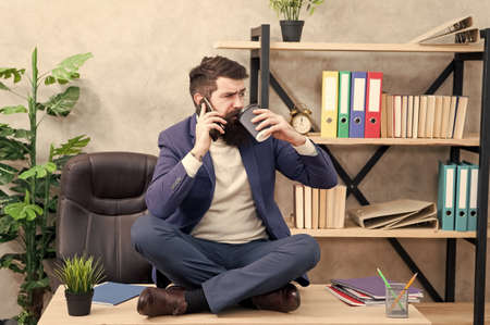 business negotiations at coffee break. sharing good news. telephone conversation. receive calls during business lunch. free time relax. mature man speak on phone while drinking coffee