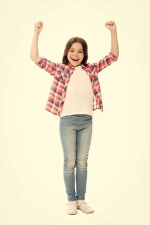 Little winner. Child care. Wellbeing and health. Upbringing versatile personality. Childhood concept. Girl child stand white background. Happy childhood. Grow mentally and physically healthy child