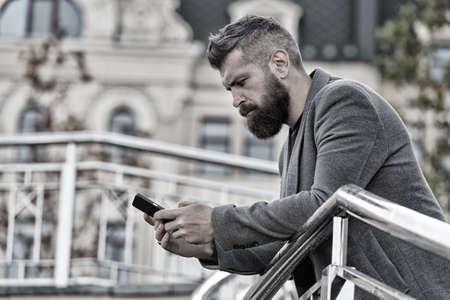 Blogging for business. Man blogger outdoor. Businessman keep business blog. Bearded man read blog post. Follow marketing blog. Real time live blog. New technology Banco de Imagens