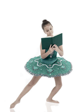 Depriving children ballerina. Most of time child dancer spend in gym training and practicing performance. No time for school studying. Girl ballerina dancing while read book. Ballet career issues