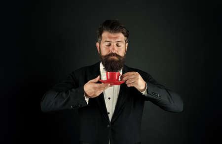 Serving perfect espresso. Man bearded hipster drinking coffee. Drinking coffee. Businessman enjoy coffee break. Relax concept. Preparing caffeine beverage using coffee machine. Cafe equipment shop