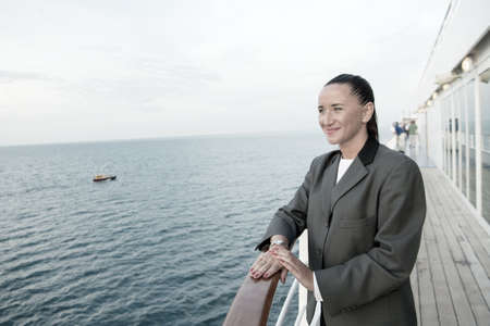pretty business woman or happy cute girl on ship deck