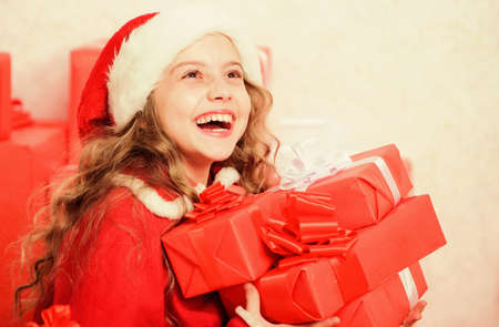 Explore christmas gifts. Unpacking christmas gift. Kid excited about christmas present. Winter miracle. Girl celebrate christmas. Santa bring her gift. Dreams come true. Winter happiness concept