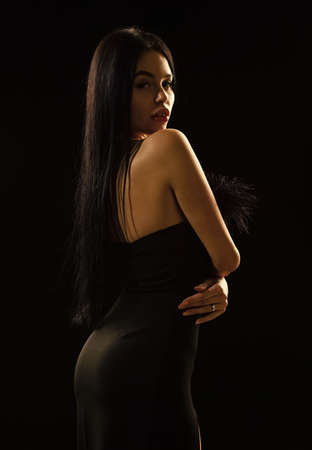 Aesthetics female beauty. Mystery concept. Mysterious fashion model. Sexy girl in darkness. Nude shoulders. Girl with long hair. Impeccable appearance. Mysterious fashion lady. Attractive woman