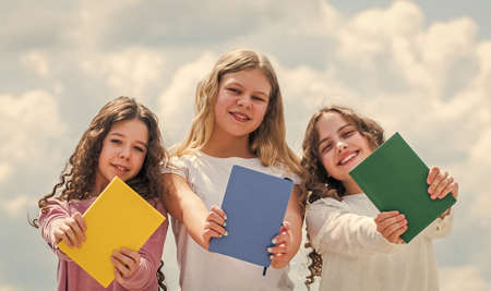 Foreign languages. Study together. Clever kids. Study group help solidify clarify material. Education concept. School students learning language. Girls with books. Smart friends. School friendship Banque d'images