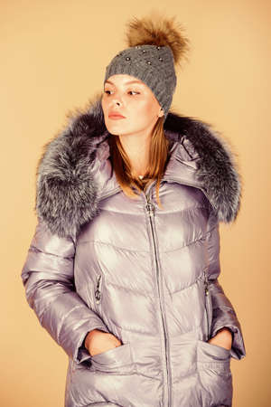 Warming up. Casual winter jacket slightly more stylish and have more comfort features such as larger hood fur trim on hood. Faux fur. Fashion girl winter clothes. Fashion coat and hat. Fashion trend 版權商用圖片