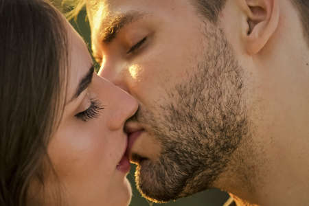 Softer than silk. delicate gorgeous kiss. man kiss woman. couple in love. I love you. Closeup mouths kissing. romantic relations. married couple kissing love on honeymoon. kissing couple portrait