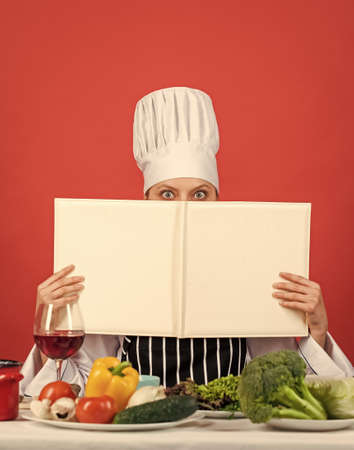 you are what you eat. woman chef read cookbook. Can be used for cooking. Food studio in restaurant. Chef preparing recipe. Recipe book. The best recipe. cooking concept. Working in a Modern Kitchen