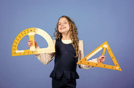 School education concept. Learn mathematics. Theorems and axioms. Smart and clever concept. Sizing and measuring. Girl with big ruler. School student study geometry. Kid school uniform hold ruler