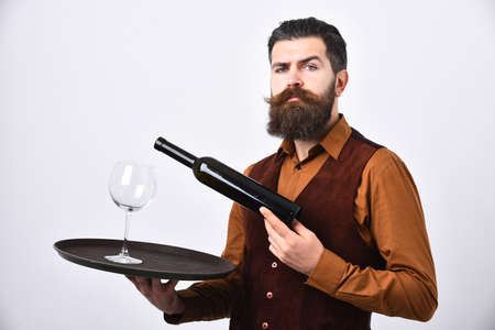Man with beard holds bottle with alcohol on white background.