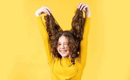 going crazy. happy girl with long windy hair. healthy and strong hair. good shampoo or lotion. hairdresser beauty salon. Strong and healthy hair concept. Small child long hair. kidding around