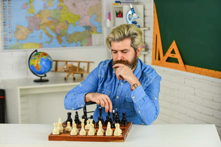 Chess is gymnasium of mind. Chess lesson. Strategy concept. School teacher. Board game. Smart hipster man playing chess. Intellectual hobby. Figures on wooden chess board. Thinking about next step