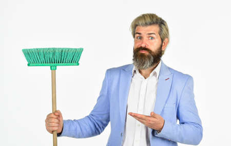 Businessman sweeping office. Unemployment and business reduction. Staff reductions concept. Business cost reduction. Where start cleaning. Clear reputation. Hipster hold cleaning tool. Man use broom