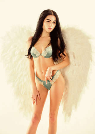 Girl wear lingerie angel feather wings accessory. Femininity and sensuality. Erotic angel. Desirable and tempting lady. Purity and innocence. Attractive sensual woman with angel wings. Fashion model