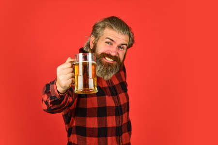 Beer festival. recreation. Man hold glass of beer. hipster at bar counter. having fun watching football. Brutal bearded male drinks beer from glass. Beer pub. Stylish bartender or barman in bar