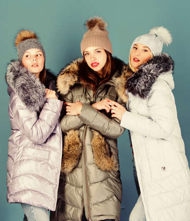 Girls friends having fun in winter. Emotional women in jackets. Group friends hang out together. Female clothes shop. Modern trendy female outfit. Gorgeous girls makeup faces cuddling. Female fashion