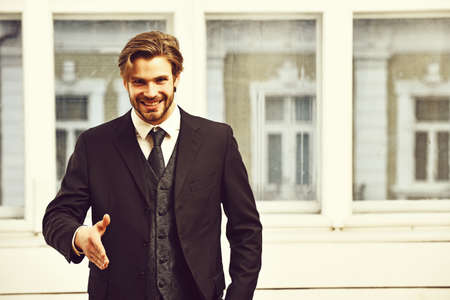 man offer cooperation with happy face in black jacket, tie