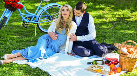 Love time. family relationship and friendship. nice summer holiday. girl and man travel on vintage bike. couple in love drink wine during romantic dinner in park. romantic picnic of couple in love
