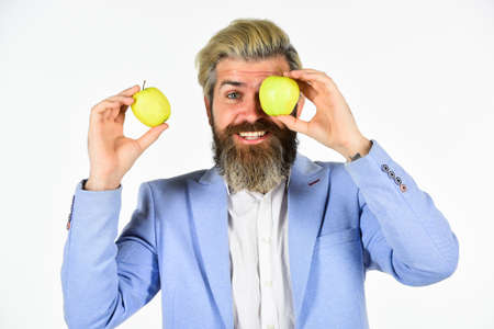 Cheerful smiling man with apples. Harvesting business. Apple became symbol for knowledge. Vitamin and diet. Fruit harvest. Successful businessman holding an apple. Business lunch. Education business