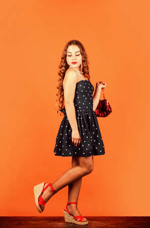 Fast fashion essentially business model companies that manufacture products. Retro fashion. Movement towards vintage fashion. Little girl makeup face curly hairstyle vintage outfit. Luxurious style 스톡 콘텐츠