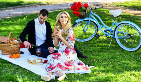 Summer day. romantic picnic of couple in love. family relationship and friendship. nice summer holiday. girl and man travel together. couple in love drinking wine during romantic dinner in park