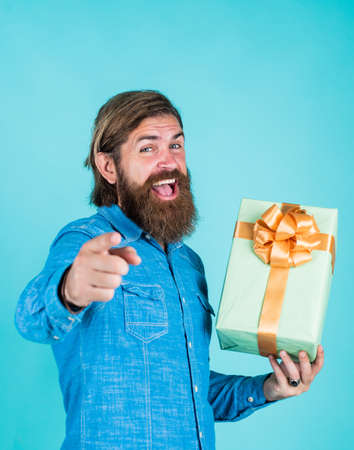 savings on purchases. cheerful brutal hipster hold gift. boxing day. birthday surprise at party. after successful shopping. prepare for holidays. best sale offer. happy bearded man with present box