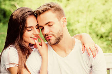 Loving couple. girl with guy in park. Beauty and fashion. family weekend. romantic date. happy valentines day. summer vibes. couple relax outdoor. Tender feeling. couple in love. Skin and hair care